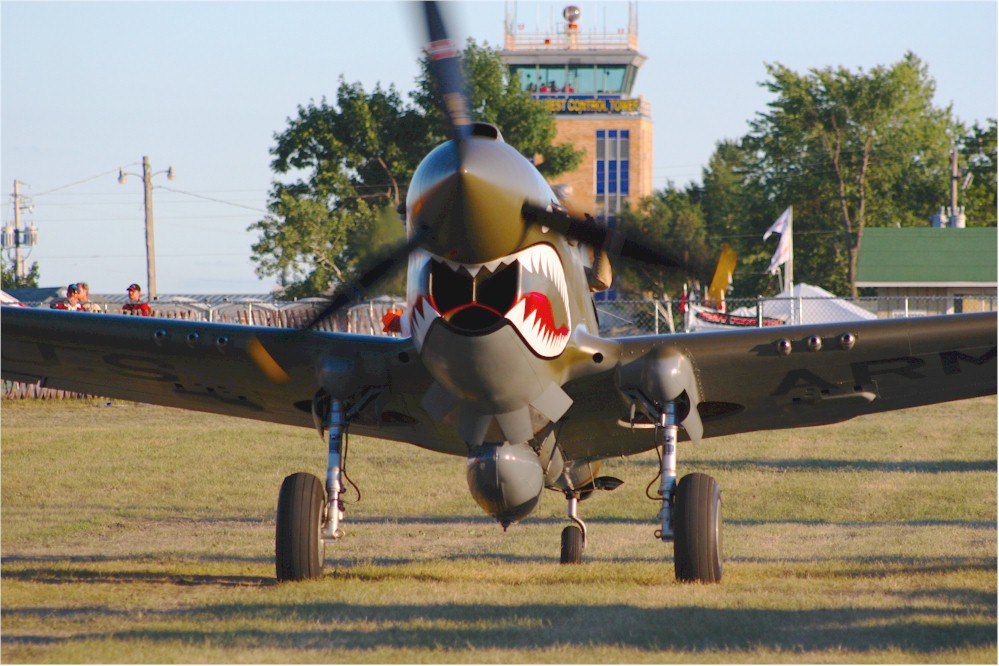 P-40 Warhawk taxies into parking area