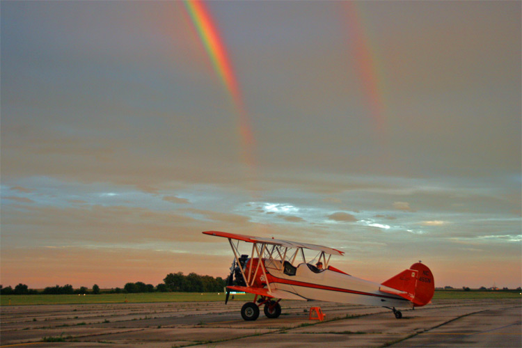 Biplane and Rainbow